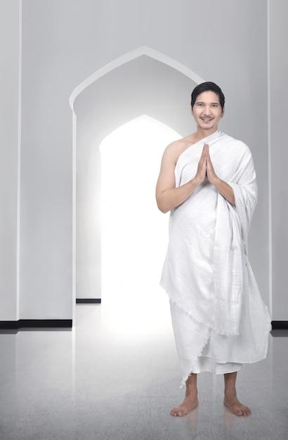 Handsome asian muslim man standing and praying Premium Photo