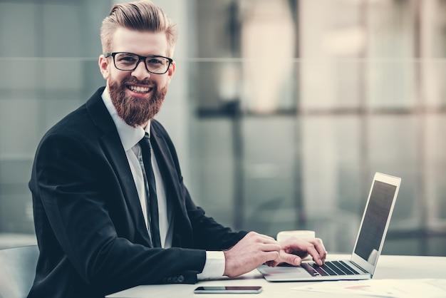 Handsome bearded businessman in classic suit. Premium Photo