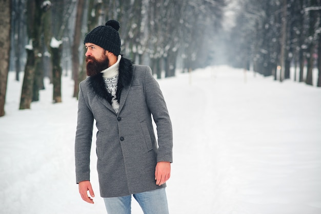 Handsome bearded man in coat and hat in winter Premium Photo