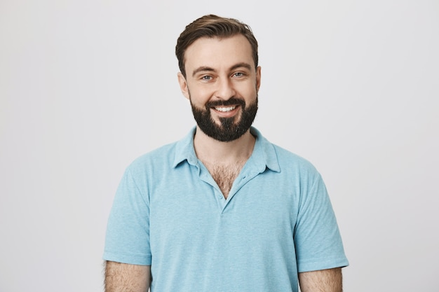 Handsome bearded man with white smile Free Photo