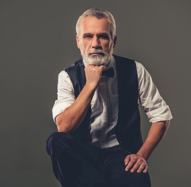Handsome bearded stylish mature man in shirt, and bow tie. Premium Photo