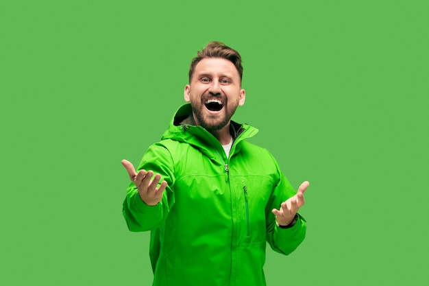 Handsome bearded young man isolated on green Free Photo