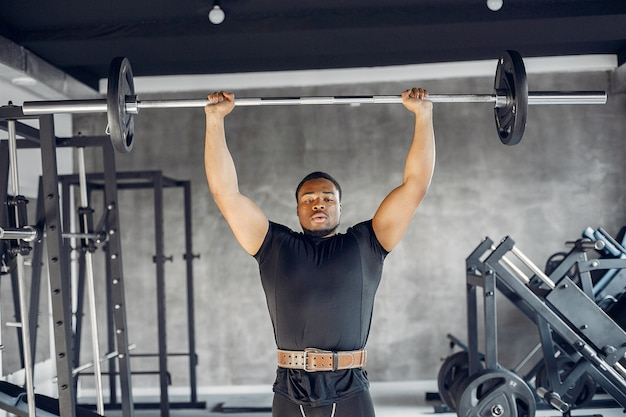 A handsome black man is engaged in a gym Free Photo
