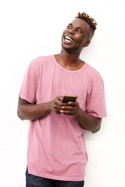 Handsome black man with mobile phone looking away on white background Premium Photo