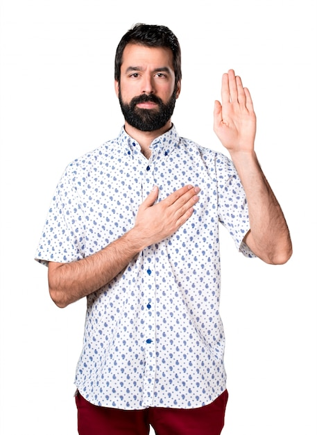 Handsome brunette man with beard making an oath Free Photo