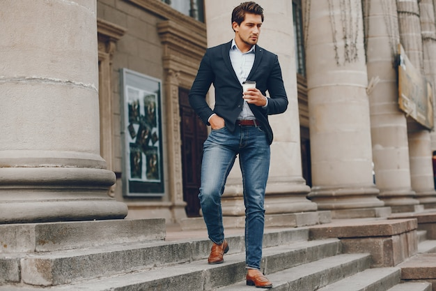 Handsome businesman in a summer city Free Photo