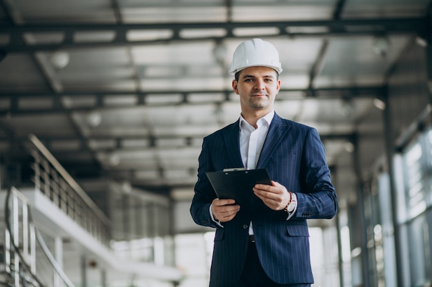 Handsome business man engineer in hard hat in a building Free Photo