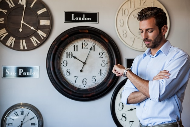 Handsome businessman checking the time Premium Photo