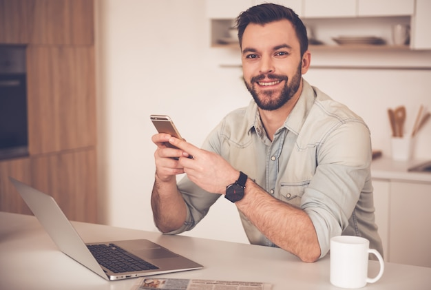 Handsome businessman is looking at camera. Premium Photo