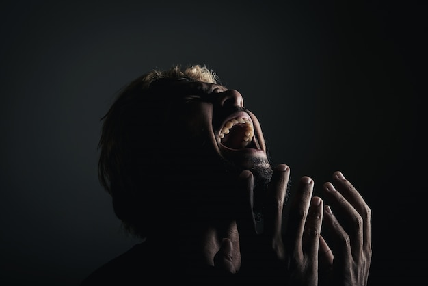handsome businessman shouting like crazy stressed with work studio