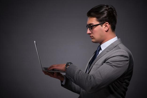Handsome businessman working on laptop computer Premium Photo