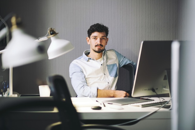 Handsome businessman working in office Free Photo