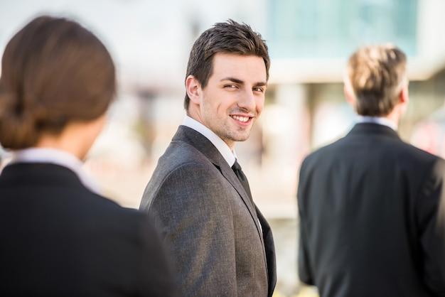 Handsome confident businessman in suit at a meeting. Premium Photo
