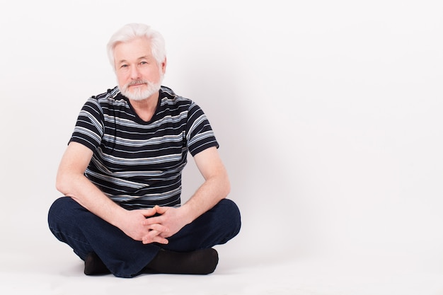 Handsome elderly man sitting Free Photo