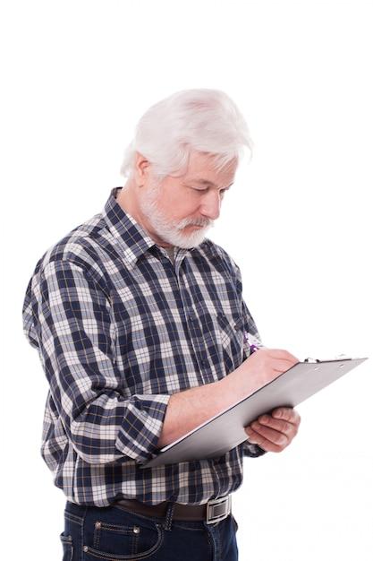 Handsome elderly man writing Free Photo