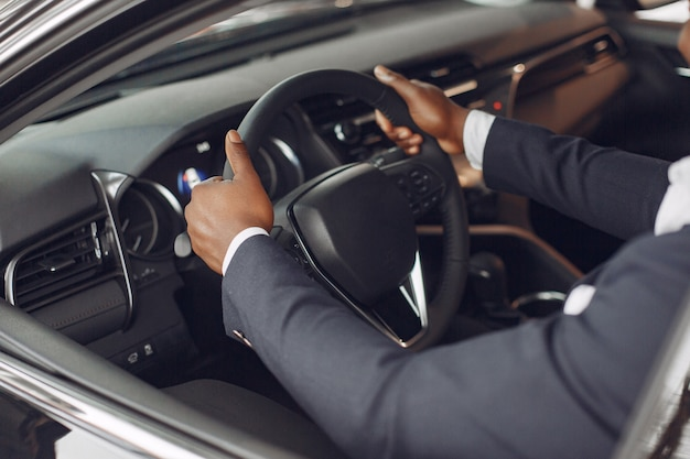 Handsome and elegant man in a car salon Free Photo
