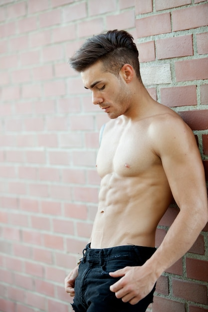 Handsome fit athletic shirtless young man Premium Photo