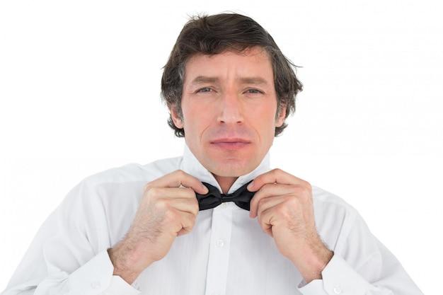 Handsome groom corrects bow tie Premium Photo