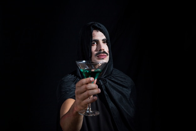 Handsomeguy in hood with wineglass Free Photo
