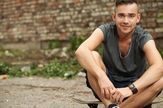 Handsome guy sitting in the street Free Photo