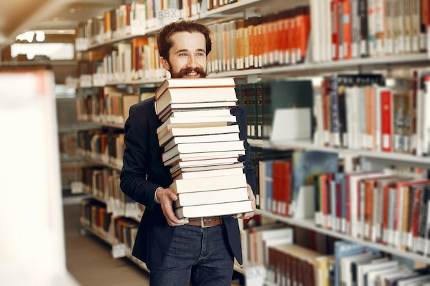 Handsome guy study at the library Free Photo