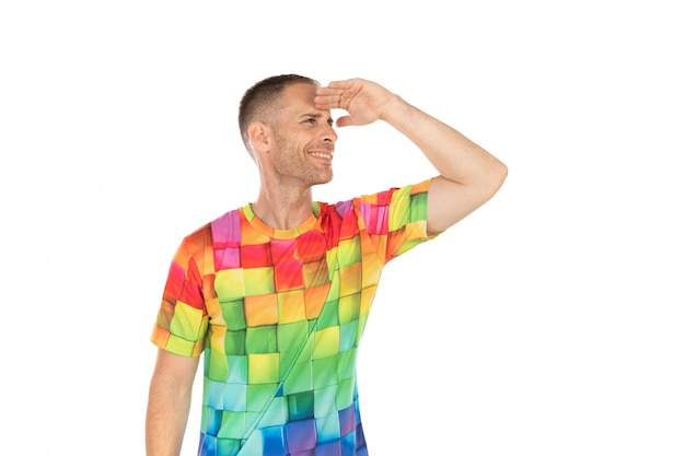 Handsome guy with colored tshirt looking something Premium Photo