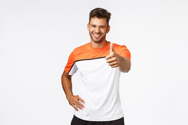 Handsome happy and healthy male athlete, sportsman Premium Photo