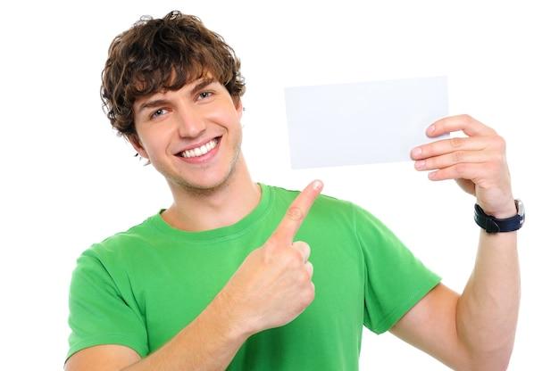 Красивый счастливый человек, показывая пальцем на пустой карточке Бесплатные Фотографии