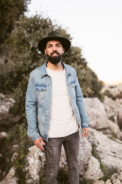 Handsome hipster man looking at photographer Free Photo