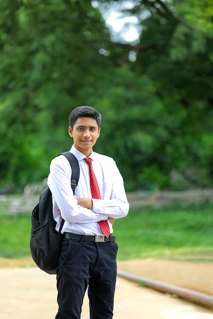 Handsome indian young boy wearing white shirt and red tie Premium Photo