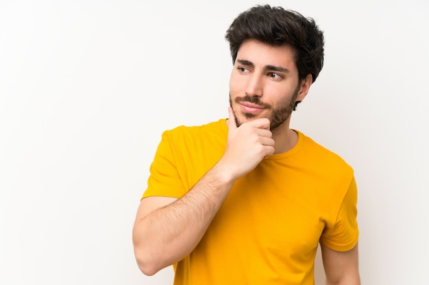 Handsome over isolated white wall thinking an idea Premium Photo