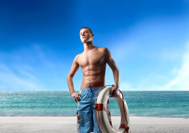 Handsome lifeguard on the beach Premium Photo