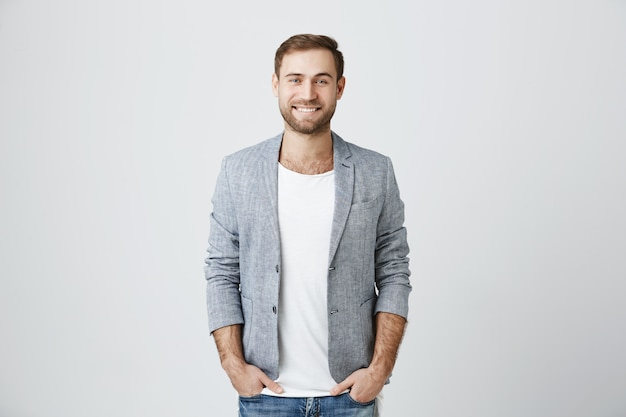 Handsome male entrepreneur smiling cheerful Free Photo
