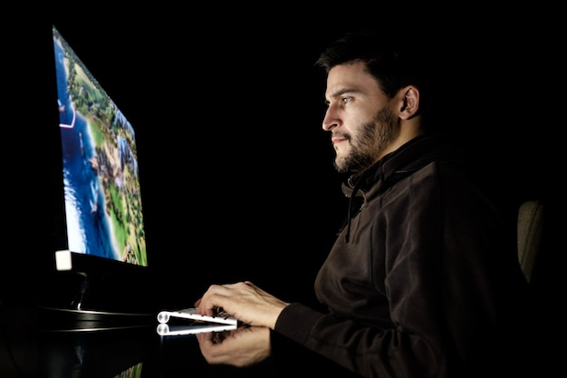 Handsome male gamer playing computer video game Premium Photo