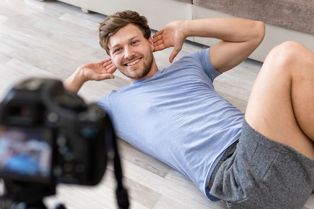Handsome male recording fitness training Free Photo