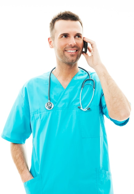 Handsome male surgeon talking on a mobile phone Free Photo