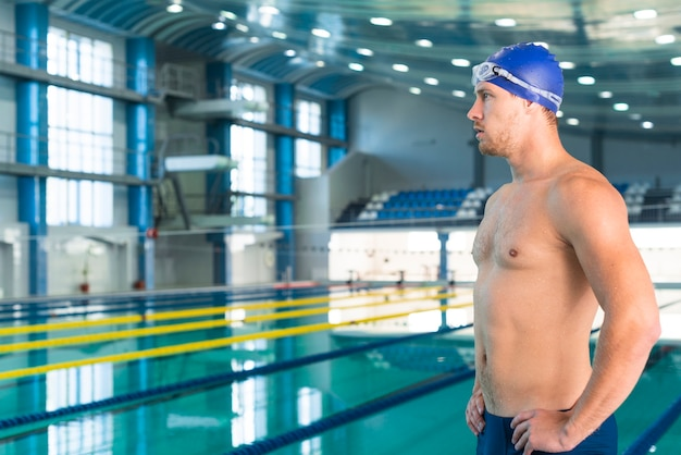 Handsome male swimmer looking away Free Photo