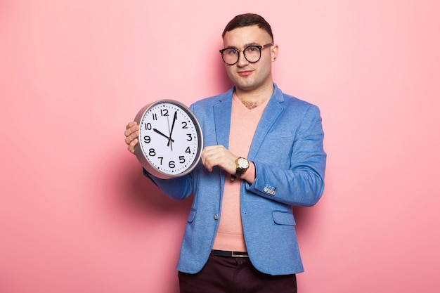 Handsome man in bright jacket with clocks Premium Photo