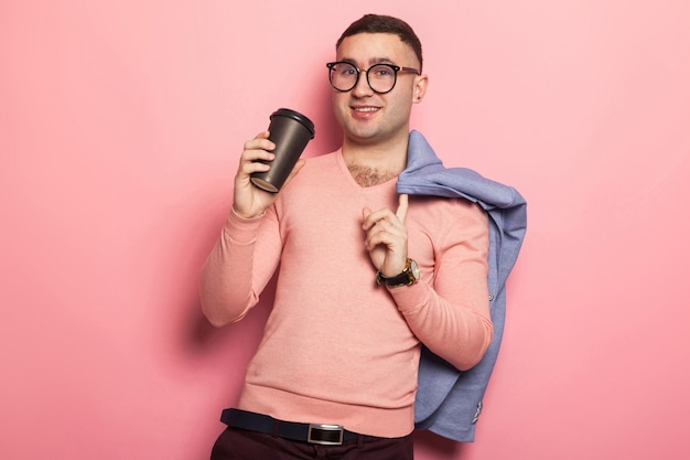 Handsome man in bright jacket with coffee cup Premium Photo