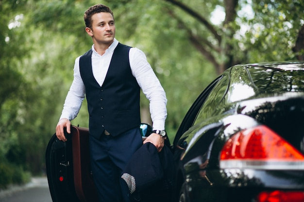 Handsome man by car Free Photo