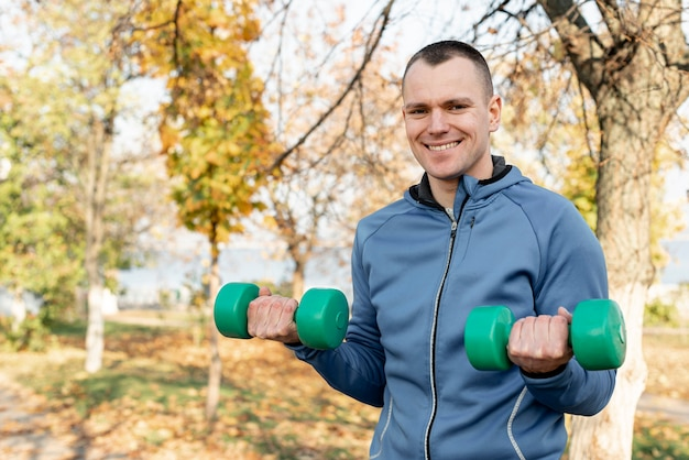Handsome man doing fitness exercises in nature Free Photo