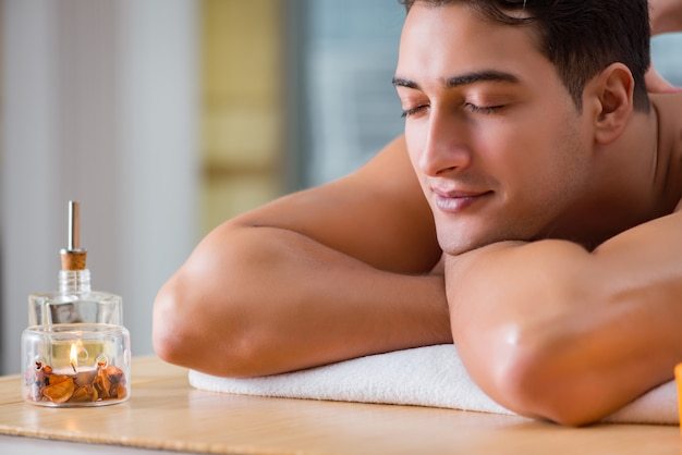 Handsome man during spa massaging session Premium Photo
