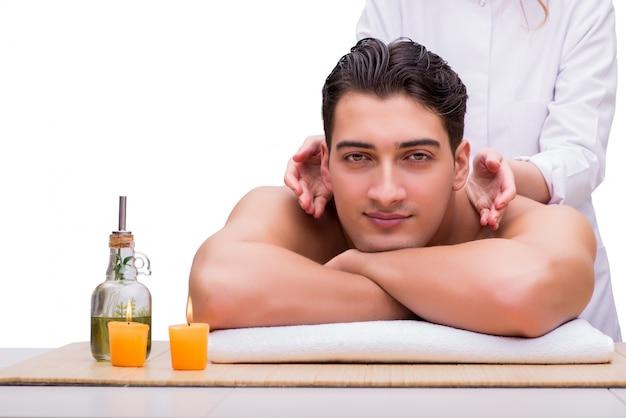 Handsome man during spa massaging session Premium Photo