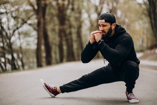 Handsome man exercising in park in sports wear Free Photo