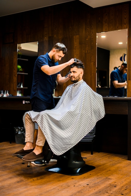 Handsome man getting a new haircut Free Photo