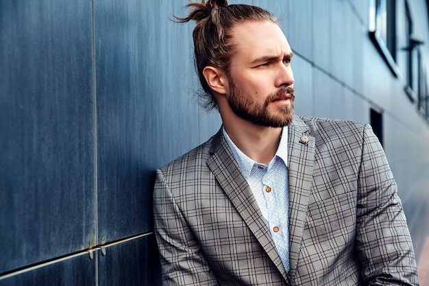 Handsome man in gray checkered suit Free Photo