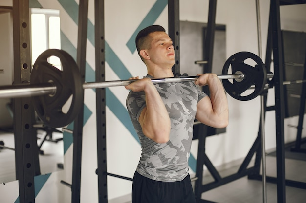 A handsome man is engaged in a gym Free Photo