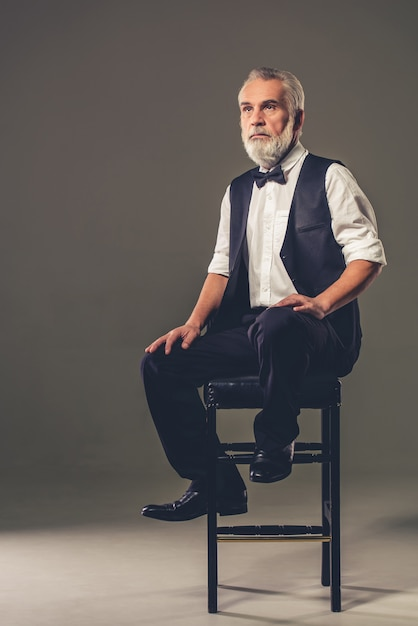 Handsome man is sitting on a chair Premium Photo