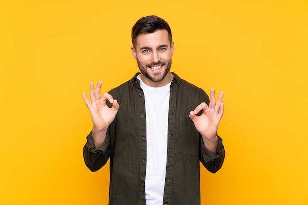 Handsome man over isolated yellow Premium Photo