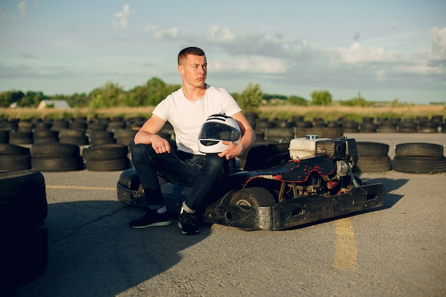 Handsome man in a karting with a car Free Photo